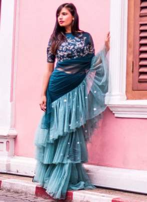 Plesance Rama Green And Blue Color Ruffle Style Saree
